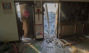 Demolished buildings seen from inside an abandoned dwelling in a migrant housing area on the outskirts of Beijing.