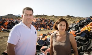 Winners of UNHCR's Nansen Award 2016, Konstantinos Mitragas and Efi Latsoudi on the beach with life jackets in background