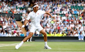 Roger Federer of Switzerland returns to Matteo Berrettini of Italy.
