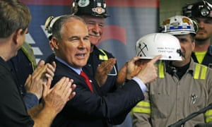 Scott Pruitt holds up a hardhat during his visit to the Harvey mine.