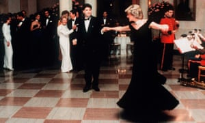 Princess Diana dances with actor John Travolta in a dress designed by Victor Edelstein, at the White House in 1985.