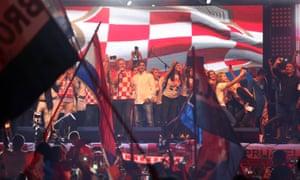 Croatian football coach Zlatko Dalic appears on stage next to Marko Perkovic 'Thompson'.