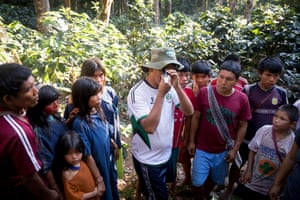 Walter Matos Contreras, who is employed by Cool Earth to work with Asháninka communities, shows villagers how to tell if the coffee is ready to pick using a refractometer, which measures sugar levels.