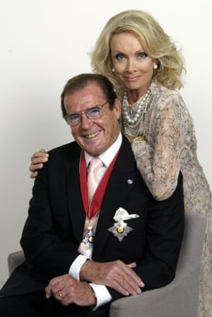 Sir Roger Moore And his wife Lady Kristina at a party in London to celebrate his Knighthood on 10 October 2003