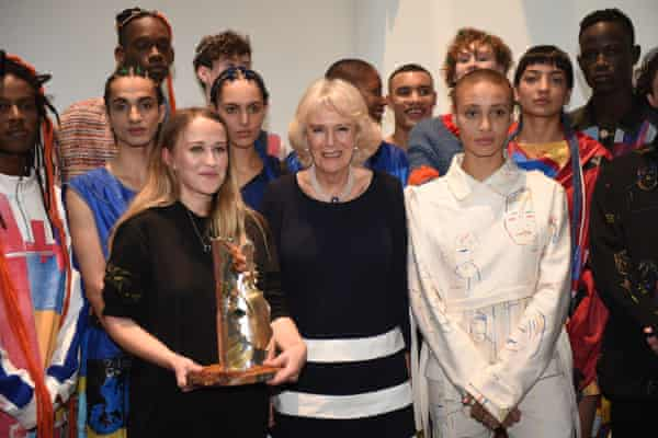 The Duchess of Cornwall (centre) with models after presenting designer Bethany Williams (centre left) with the Queen Elizabeth II award for design.