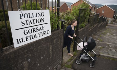 A voter leaves a polling station at the Elim pentecostal church in Merthyr Tydfil, south Wales.