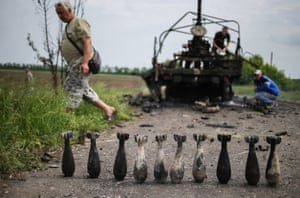 Locals in Slavyansk examine the aftermath of a military clash between separatists and Ukrainian forces, May 2014.