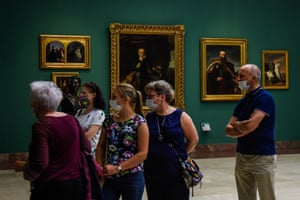 People visit the permanent exhibition of the Sukiennice National Museum of 19th-Century Polish Art in Kraków, Poland