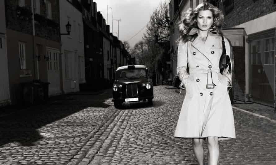 Kate Moss models a Burberry trenchcoat.