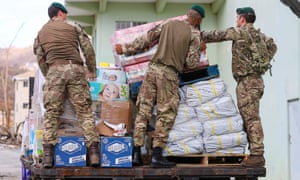 British troops distribute aid on the territory in anticipation of Hurricane Maria.
