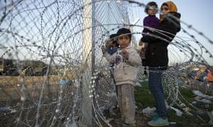 Families gather at the fence at the Greek-Macedonia border near Idomeni, Greece