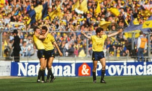 Malcolm Shotton. left, congratulates Jeremy Charles on  Oxford United's third goal against QPR in the 1986 League Cup final, as Kevin Brock celebrates