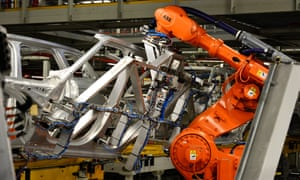 A robot works on cars at Jaguar Land Rover, in Solihull, West Midlands.