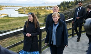 Angela Merkel (right) with Iceland's prime minister, Katrin Jakobsdottir, at Thingvellir national park in Iceland. Merkel is attending a meeting of the heads of the Nordic countries.