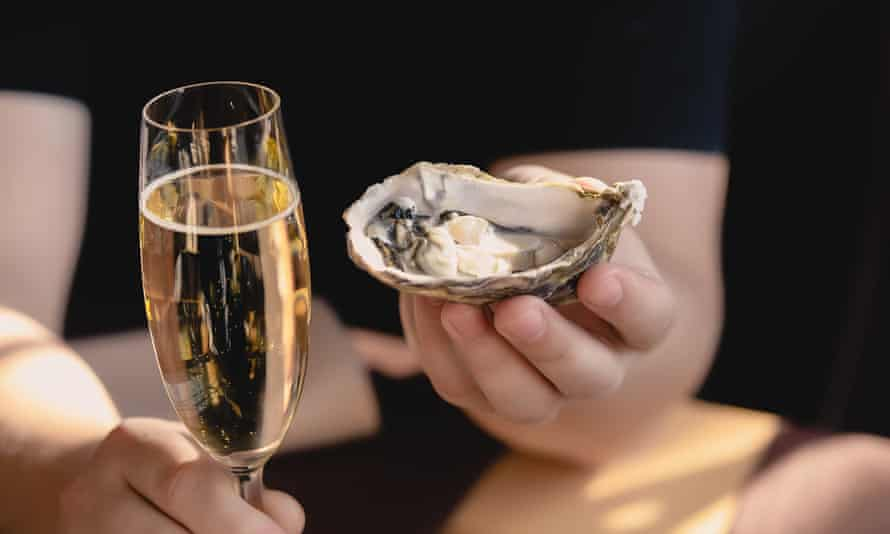 An oyster and a glass of champagne