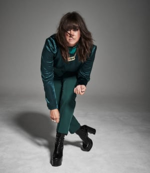 Cat Power standing, leaning forwards, in Satin top by Ann Demeulemeester (net-a-porter.com); trousers by dorothyperkins.com; Joplin buckle boots Saint Laurent by Anthony Vaccalerro by ysl.com; and necklace by viviennewestwood.com.