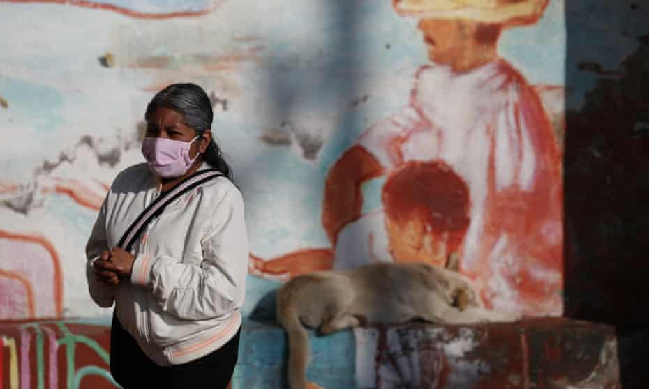 A woman rubs antibacterial gel into her hands as she waits in a distanced line to get tested for Covid-19 at a mobile diagnostic tent in San Gregorio Atlapulco in the Xochimilco district of Mexico City on Wednesday.