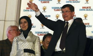 Turkey's prime minister and leader of the ruling Justice and Development Party Ahmet Davutoğlu, accompanied by his wife Sare Davutoğlu, waves to supporters from the balcony of his party in Ankara, Turkey.