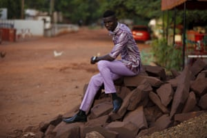 Model Mamadou Racine in a purple shirt and matching trousers