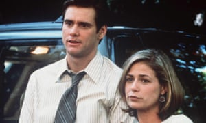 Jim Carrey and Maura Tierney, standing side by side looking thoughtful, in Liar Liar, 1996.