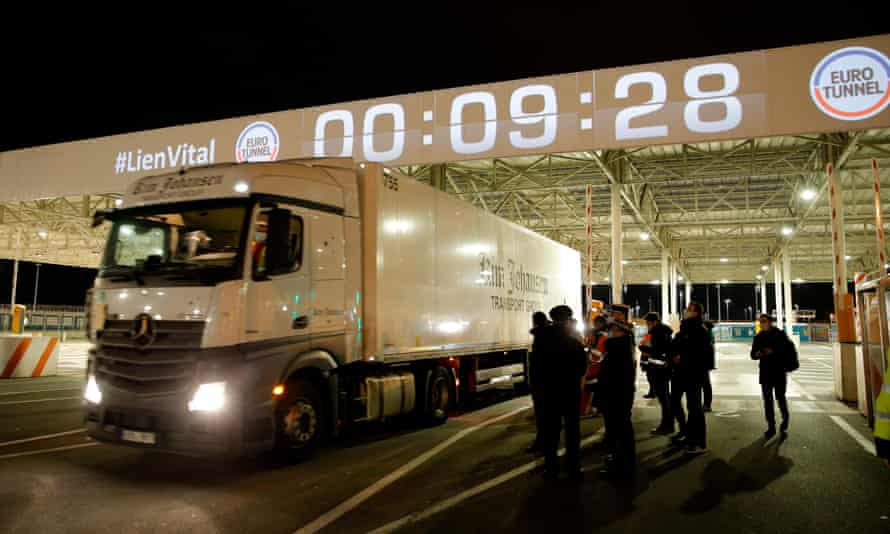 Frech custom offciers watch the first vehicle entering the Eurotunnel terminal post Brexit