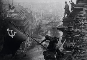 Soviet soldiers raising the red flag over the Reichstag, May 1945 by Yevgeny Khaldei.