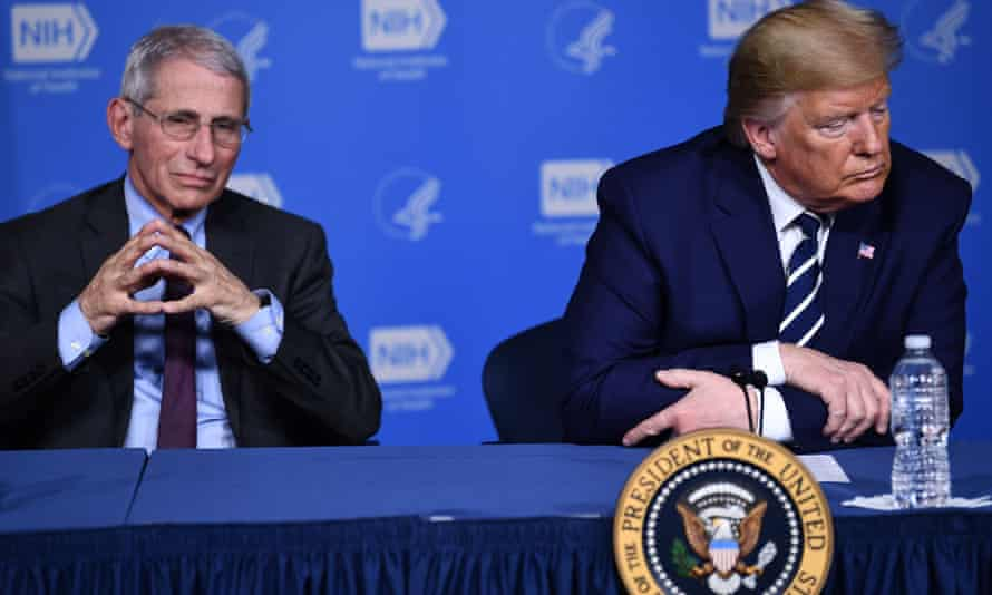 Donald Trump and Anthony Fauci, director of the NIH National Institute of Allergy and Infectious Diseases attend a meeting at the National Institutes of Health in Bethesda, Maryland, on Tuesday.