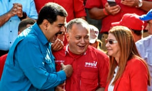 President Nicolás Maduro, left, talks member of the constituent assembly Diosdado Cabello and first lady Cilia Flores at a rally in Caracas on Tuesday.