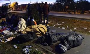 Refugees sleep in the open near Calais