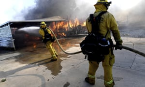Firefighters battle the Sandalwood Fire in southern California.