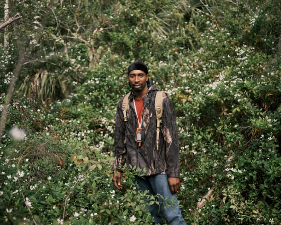 Pompi Rodriguez poses for a portrait as he goes hunting for feral hogs with his trained hunting dogs earlier this month in Poinciana, Florida.