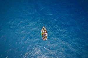 A boat carrying migrants is stranded in the Strait of Gibraltar before being rescued by the Spanish Guardia Civil and the Salvamento Maritimo sea search and rescue agency.