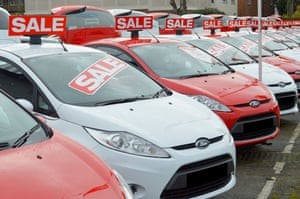 A car dealership showing Ford cars on sales.