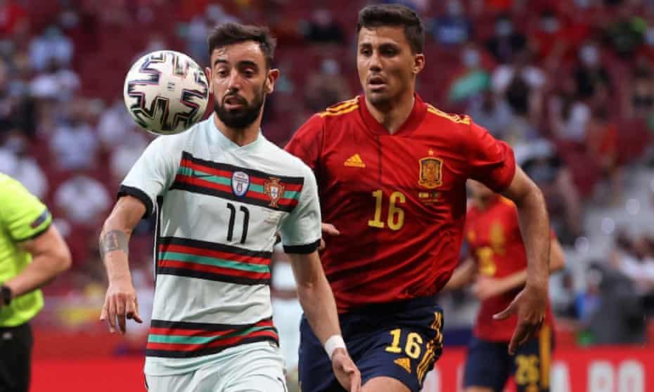 Rodri challenges Bruno Fernandes in Spain's recent friendly against Portugal.