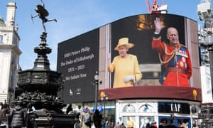 Queen and Philip on screen at Piccadilly Circus