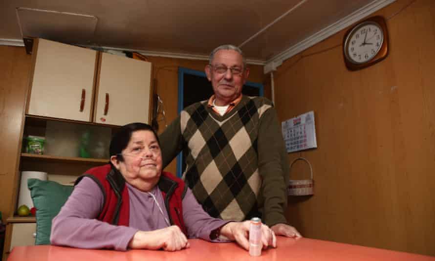 Marta Muñoz and Luis Espinoza at their kitchen table in Coyhaique.