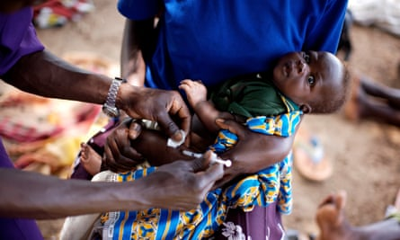A baby is injected during a UNEPI immunisation programme for babies at the Katine health centre.