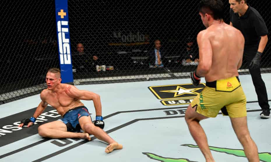 Niko Price is dropped by a punch from Vicente Luque in their welterweight fight.