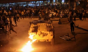 Egyptian Christians clash with soldiers and riot police during a protest against an attack on a church in Cairo.