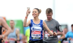 A runner takes a photo on her phone