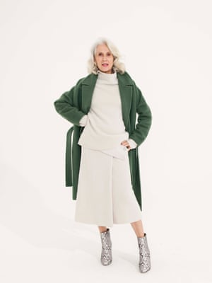 green coat Arket, cream roll neck top Cos, cream wrap over skirt Cos, grey and white animal print ankle boots Reiss