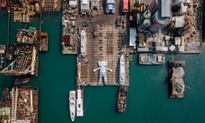 A 121-foot-long inflatable installation of American contemporary artist Brian Donnelly's famous Companion seen at rest in a shipyard in Hong Kong