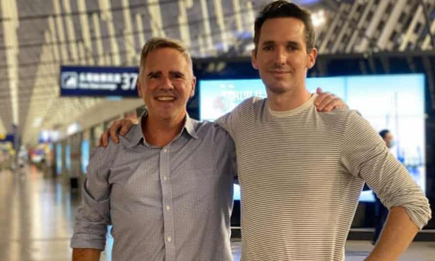 The Australian Financial Review's Michael Smith and the ABC's Bill Birtles at an airport