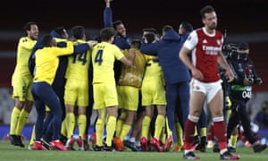 Villarreal players celebrate at the final whistle.