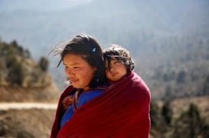 A woman carries her daughter near Punakha.