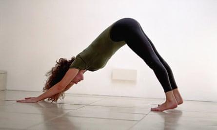 A woman practises yoga