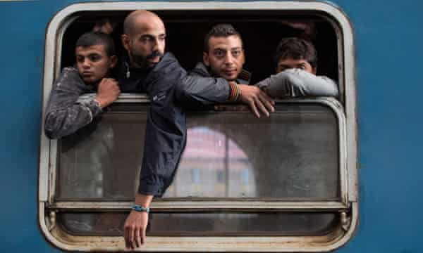 Refugees board a train in Keleti station after it was reopened in central Budapest on 3 September.