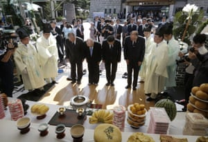 North Korean refugees pay their respects to ancestors during a ceremony to mark the forthcoming Chuseok holiday.