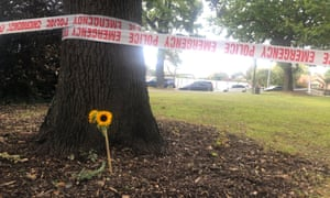 a flower next to police tape
