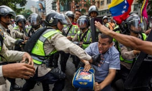Demonstrators clash with police during a protest in Caracas.